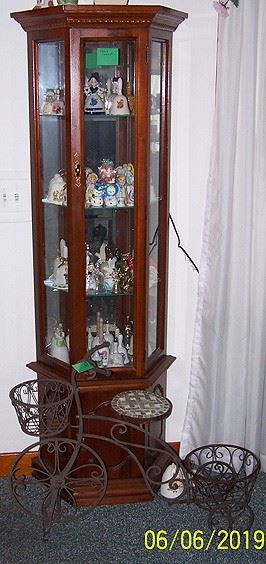Curio cabinet, bell collection and tricycle plant stand