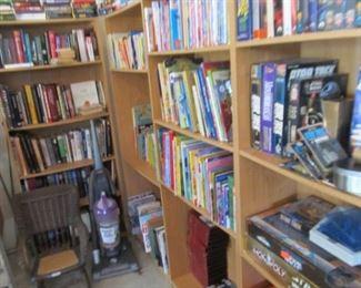 Four shelves of books, etc.