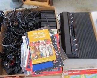 Atari 2600 with controllers and instructions and all parts.  Many, many games