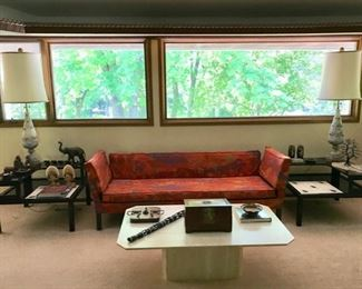 Mid Century Modern Drop Arm Sofa (Dunbar by Edward Wormley) with Hinged Arms (Jack Lenor Larsen Fabric), MCM End Tables with Atomic Motif (The Tilers), Marbro Lamps, and Travertine Coffee Table