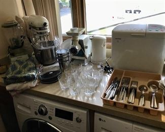 Chef Mate Bread Maker, Kitchen Aid Mixer, `Oster Grinder,  Stainless Steel Flatware Set,  Vintage Aprons,  and more...