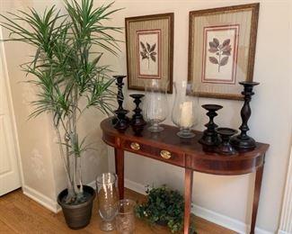 Set of 4 botanical framed prints, black pottery barn candlesticks, clear glass pottery barn hurricanes, Sherrill demilune