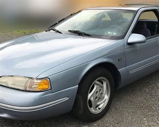 At 8PM: 1997 Ford Thunderbird LX with Light Blue Exterior, Luxe Dark-blue Cloth Interior; 2-Door Body Styling; Power Windows, Locks, Mirrors; Power Moonroof; AM/FM Stereo with Cassette; Air Conditioning; Rear Deck Spoiler; 65,486 Miles, and more! | VIN: 1FALP62W1VH143955 Vehicle Terms: - Vehicles are sold AS IS, in AS FOUND/ESTATE condition. - Minimum of 10% deposit due on day of auction (Cash, Check, VISA, MC, Debit). - Balance paid in full by Thursday following (Cash or Certified Bank Check ONLY).