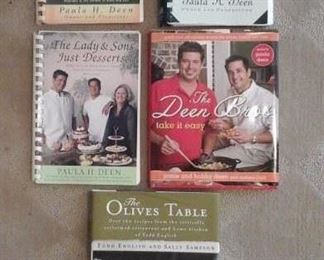 Four Paula Deen cook books signed by all family members and signed Todd English cook book.