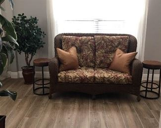 Rattan love seat  has  matching chairs