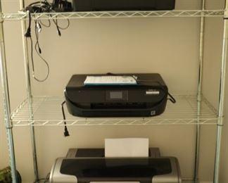 Top to bottom: HP Photosmart printer, HP envy 4520, Epson Photo Stylus printer R1800