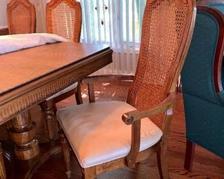 Bernhardt dining table w/6 cane back chairs, 2 leaves and table pads
