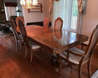 Bernhardt dining table w/6 cane back chairs, 2 leaves and table pads  - this photo is with all the leaves in the table