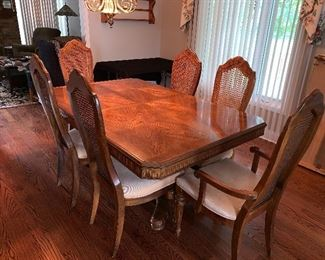 Bernhardt dining table w/6 cane back chairs, 2 leaves and table pads - this photo is without the leaves in