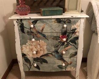 chest, vintage pink vase, book, picture frame
