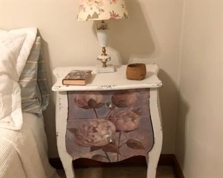 night stand, book, small basket, vintage lamp