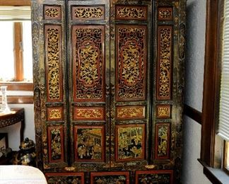 Intricately carved and painted Chinese cupboard