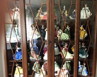 About 100 Royal Doulton figurines in 3 different cabinets