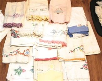 Over 25 pair of embroidered pillowcases