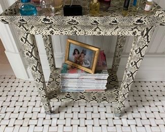 126. Faux Snakeskin Side Table on Casters (19'' x 12'' x 24'')