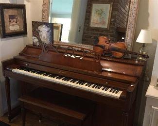 Upright piano, antique violin, incredible mirror