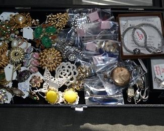 vintage jewelry pieces including sterling