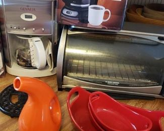 Never used Gevalia Coffee Maker, Black and Decker Toaster Oven, and other Enameled cookware plus a Mr. Coffee.