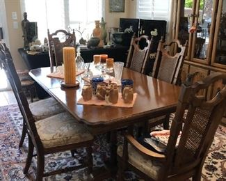 Vintage Dining set including 2 additional chairs, 2 leaves and custom pads.  Matching China Cabinet