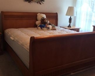 King Size Bed with Wooden Headboard and Footboard. Sealy Posturepedic Patronage Plush Mattress.