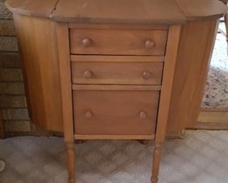 One of two sewing cabinets