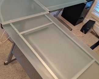 Corner glass and silver metal computer desk. 3 pieces, so it will fit in any office space