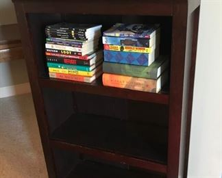 Small brown wood book shelf and kids books