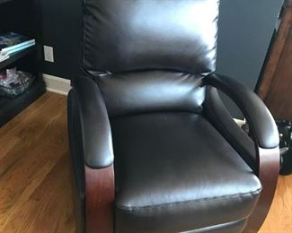 Dark brown leather,contemporary recliner with mahogany trim arms