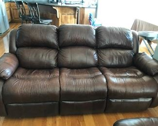 Distressed brown leather reclining couch