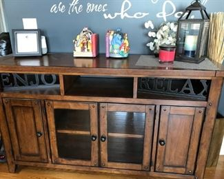 Rustic Media cabinet constructed in solid hardwood with a distressed age look.
