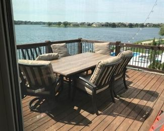 Patio table with 6 chairs and umbrella stand
