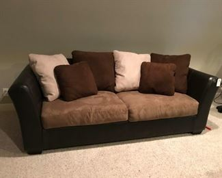 Two-tone sofawith tan / brown pillows and pair of matching chairs
