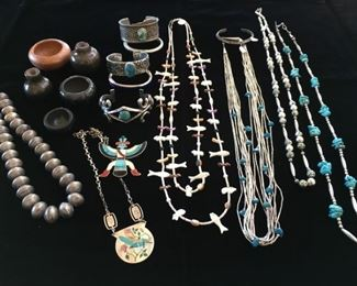 Native American jewelry and miniature pots