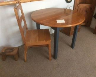Wood table and one chair.