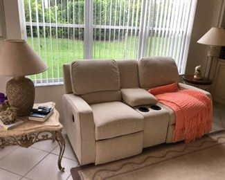 Almost new electric reclining loveseat, smoke free, stain free and pet free home.   $300