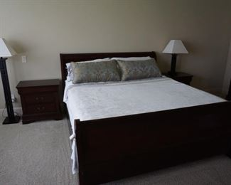 Master Bedroom Furniture. Queen Sized Bed. Modern Lamps and Wooden Night Stands.