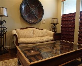 Large Wooden Table with Glass Top. Large Metal Mosaic Decorative Piece. Metal Lamps.