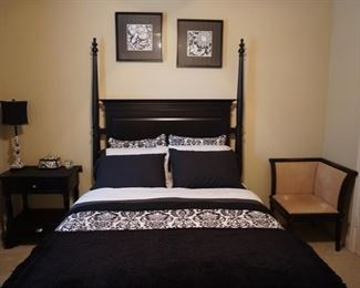 Full Sized Modern Bed with Modern Bedroom Furniture and Artwork.