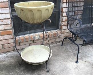 Wrought iron and pottery for patio icing drinks.