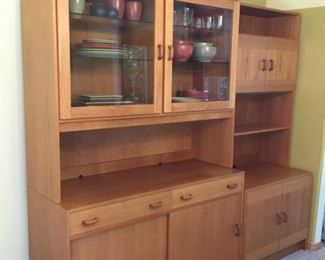 Domino Mobler China Cabinet is approx. 48 in L x 20in D x 72in H. Top hutch of china cabinet is approx 15.75 in D. Bookcase measures approx 31 in. L x 20 in. D x 72 in. H. (Top shelf measures approx 11.5 in. D. )