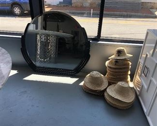 Black vintage mirror. $75 Straw hats. $5