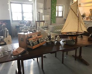 This is a solid Mahogany one slab table. 120x37.   Was $5000 asking $1800.  Wired underneath if want to put a lamp on it.  How cool is that.  I can't even!  Old sailboat =awesome