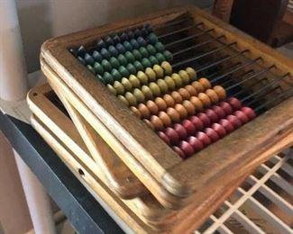 Several vintage abacus