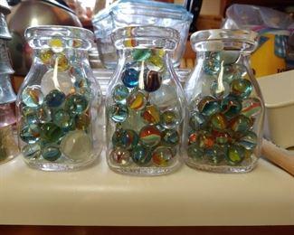 Vintage marbles in half pint milk bottles