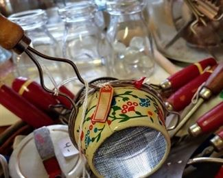 This little Floral enamel strainer still has the red and white string hang tag you can barely see Japan