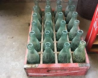 Coca-Cola bottles in crate