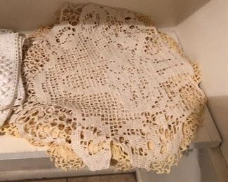 Tons of vintage doilies and handmade crochet