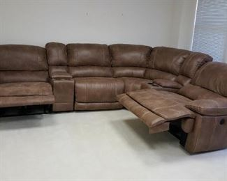 Leather sofa with two power recliners and one manually operated.