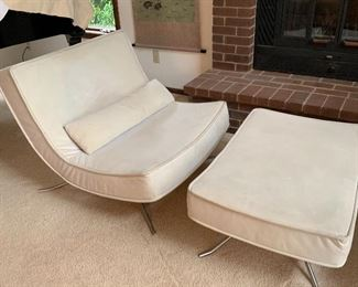 "Pair of Ligne Roset POP chairs with matching ottoman. The Ligne Roset POP chair is a design that interprets the simplest shape, the curve. The deep, upholstered Butler seat ensures outstanding comfort, balanced on a stationery steel frame. 35.5""W x37.5""D x32""H"