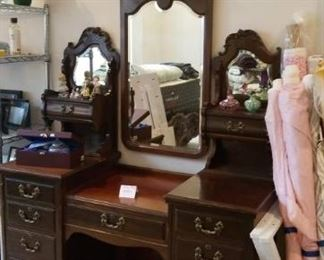 Master bedroom vanity with triple mirrors